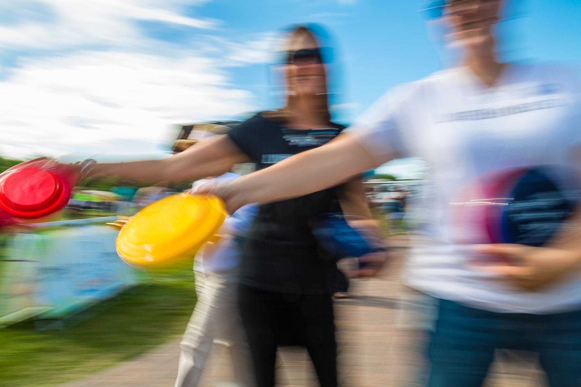 IMAGE: People throwing frisbees in St. Cloud