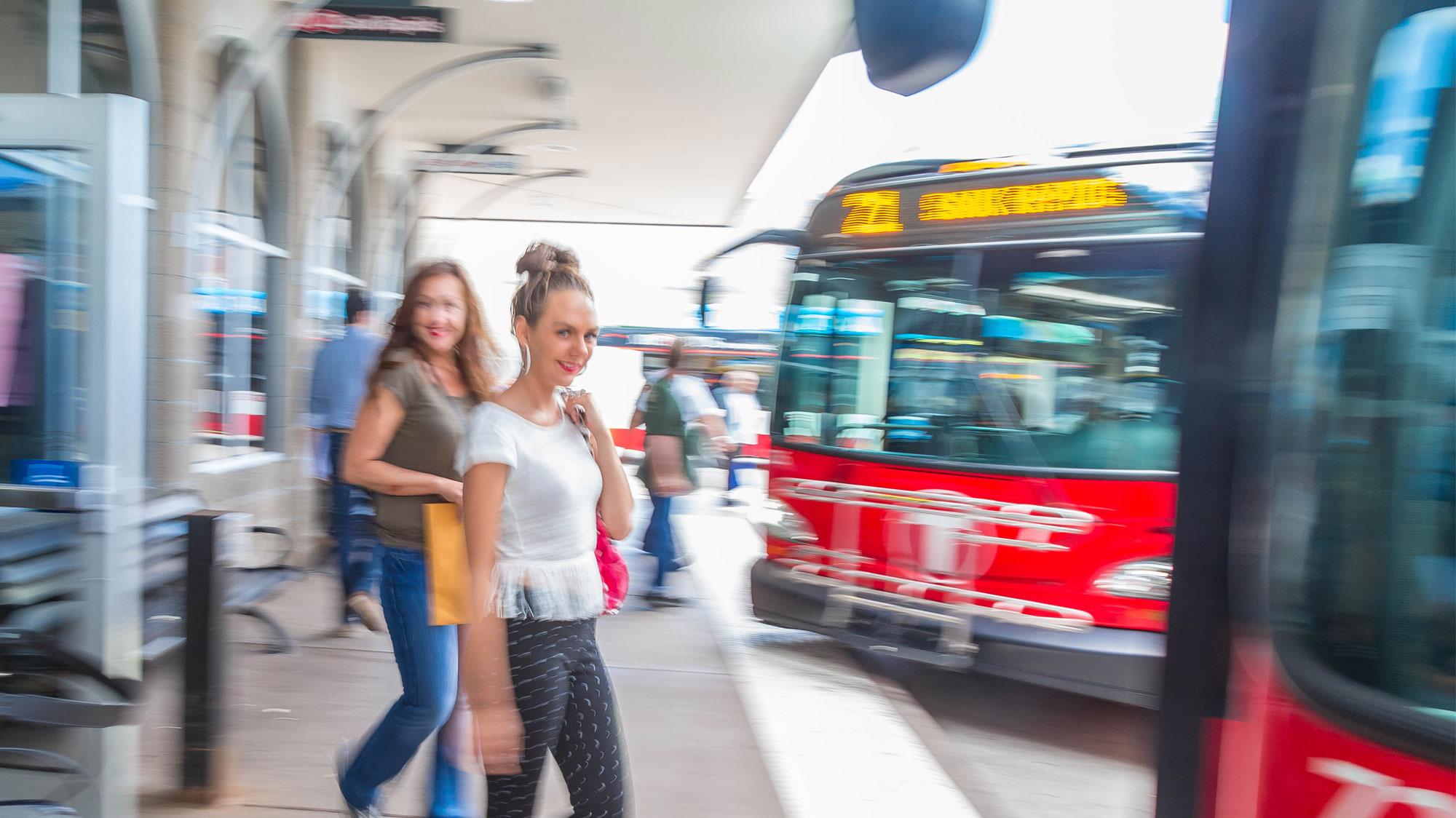 IMAGE: Passengers Boarding Metro Bus at Transit Center