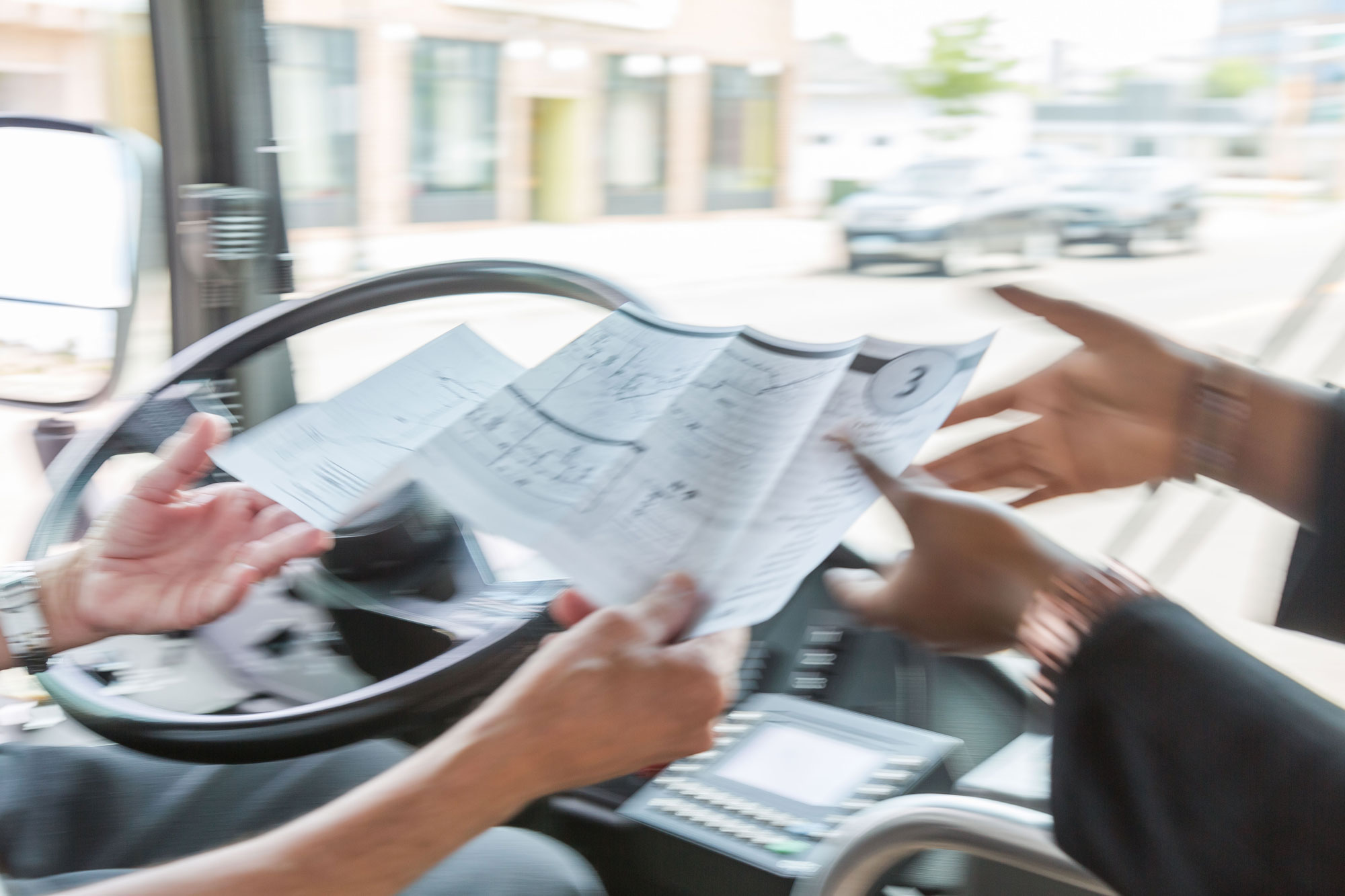 IMAGE: Metro Bus Driver Helping Passenger with Route Map