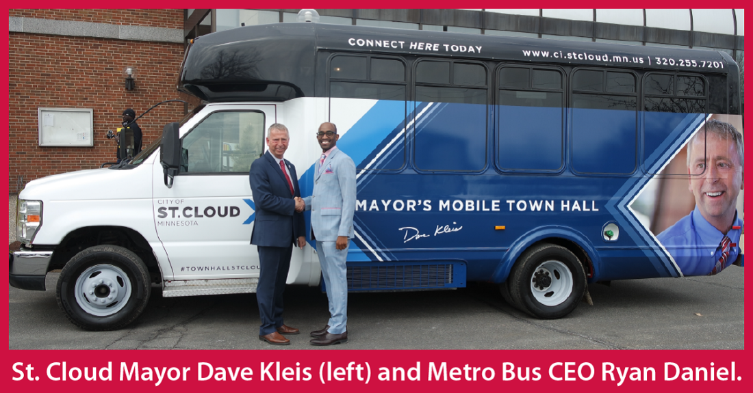 IMAGE: St. Cloud Mayor Dave Kleis shaking hands with Metro Bus CEO Ryan Daniel in front of the Mayor's Mobile Town Hall Bus.